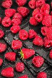 Fresh red raspberries on a slate background