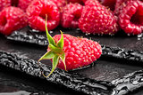 Delicious red raspberry on a slate table