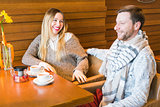 Woman talks with man sitting at the coffee house