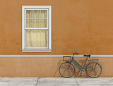 Old facade with window and bicycle