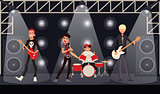 Rock band musicians perform on stage