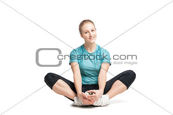 Beautiful sporty woman sitting on the floor