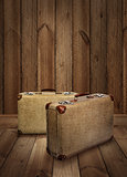 Vintage suitcases on wooden plank background