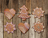 Christmas gingerbreads on old rough wood plank