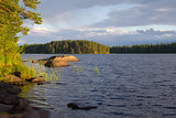 Finnish lake with stones in the water.