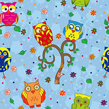 Funny owls and tree seamless pattern over blue