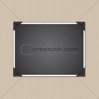 Blank photo frame on cardboard texture