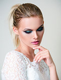 Studio fashion shot: beautiful young girl in white dress