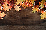 Fall Leaves and Lights over Wooden Background