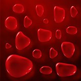 Transparent red color drops on black background.