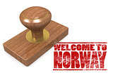 Red rubber stamp with welcome to Norway
