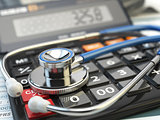 Health care costs concept. Stethoscope and calculator  of medica