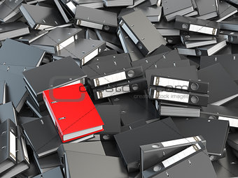 One red office binder and pile of black others.  Archive. File s
