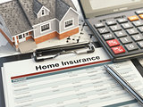 Home insurance form, house, calculator and binders,