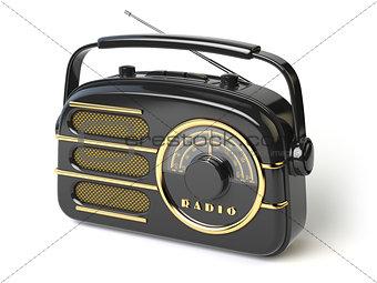 Black vintage retro radio receiver isolated on white.