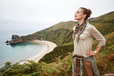 relaxed active woman hiker in front of ocean view landscape