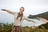 woman hiker having fun time in front of ocean view landscape