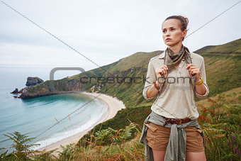 adventure woman hiker in front of ocean view landscape