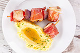 Delicious poultry and bacon kebab.