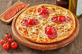 Salami pizza with cherry tomatoes