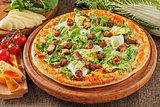 Pizza with meat and salad