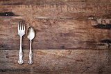 Antique Silverware over Rustic Wooden Background