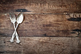Antique Silverware over Wooden Background
