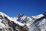 Mountain peaks in winter at sunny day