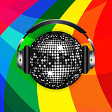 Disco ball and headphones over rainbow background