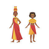 Two Women In Yellow And Red Dresses From African Native Tribe