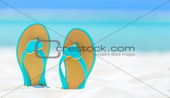 Flip Flops with hearts on a sandy beach