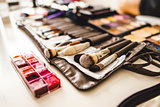 makeup cosmetics and brushes on the table