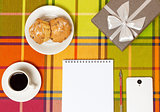 Coffee muffins smartphone on the table