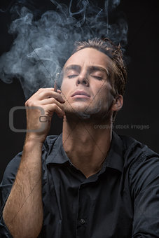 Portrait of man with cigarette