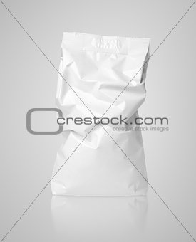 Crumpled blank paper bag package with creases on gray