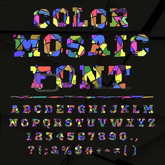 Broken colored alphabet on a dark background