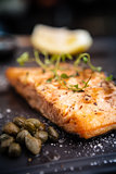Salmon steak served on a warm plate