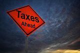 Taxes Ahead warning road sign