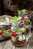 Detox drink with fresh berries in glass jars