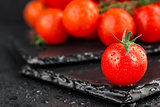 Cherry tomatoes on slate backgound