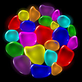 Transparent color drops on black background.
