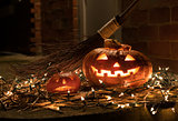 Halloween pumpkin with witches broom.