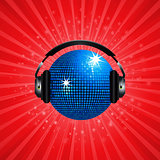 Blue disco ball and headphone on red background