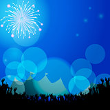 Festival tends and crowd with firework