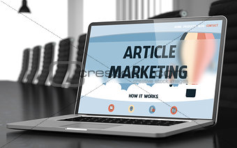 Article Marketing on Laptop in Meeting Room.
