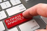 Hand Touching Business Analytics Button.