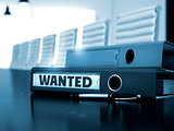 Wanted on File Folder. Blurred Image.
