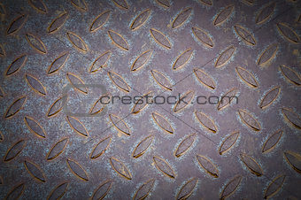 Old metal plate with raised pattern,