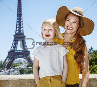 portrait of mother and daughter travellers in Paris, France