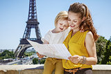 mother and daughter exploring attractions in Paris, France